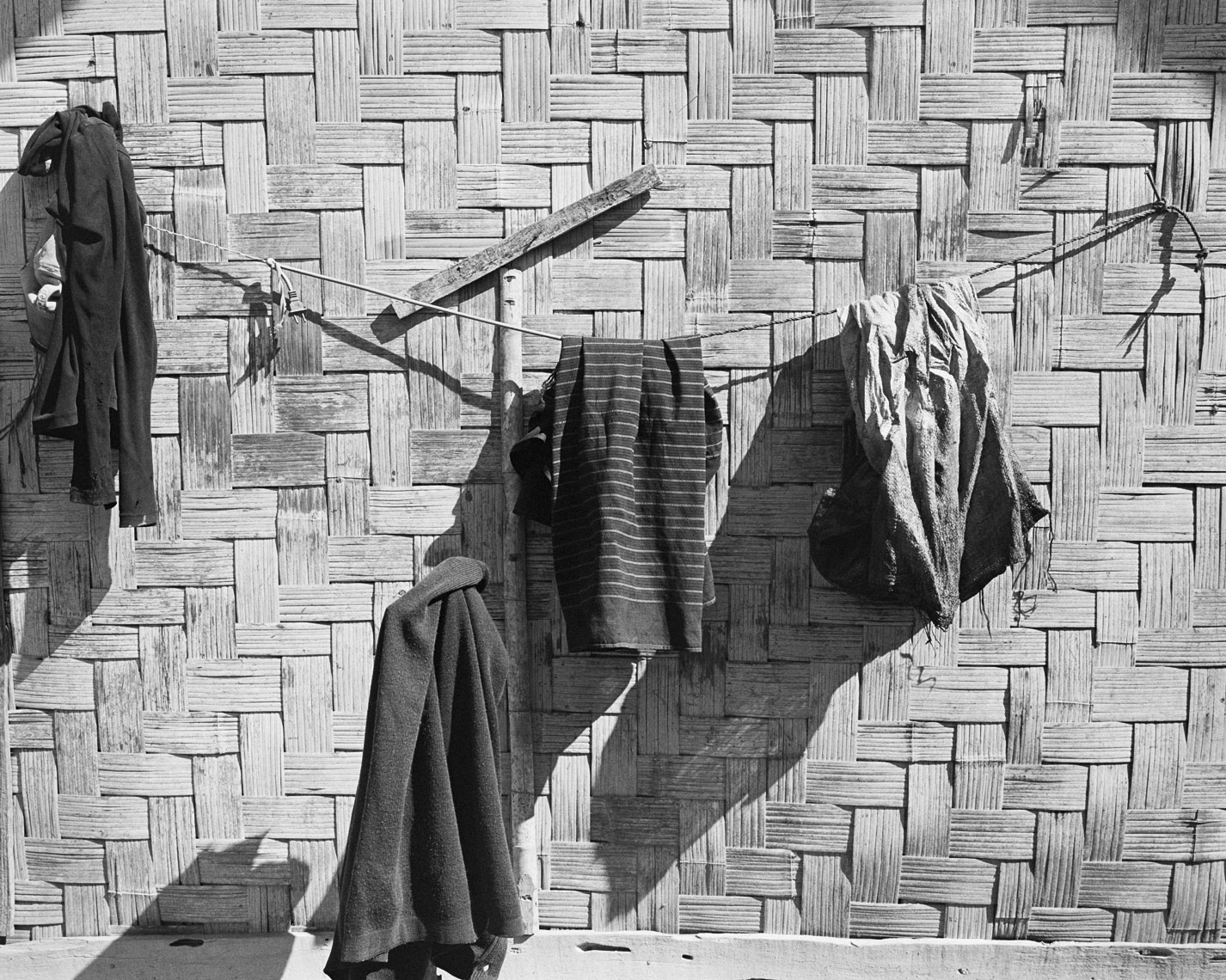 Bamboo-wall-with-clothes
