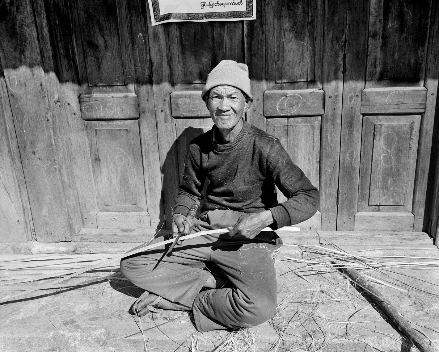 Man cutting bamboo.jpg