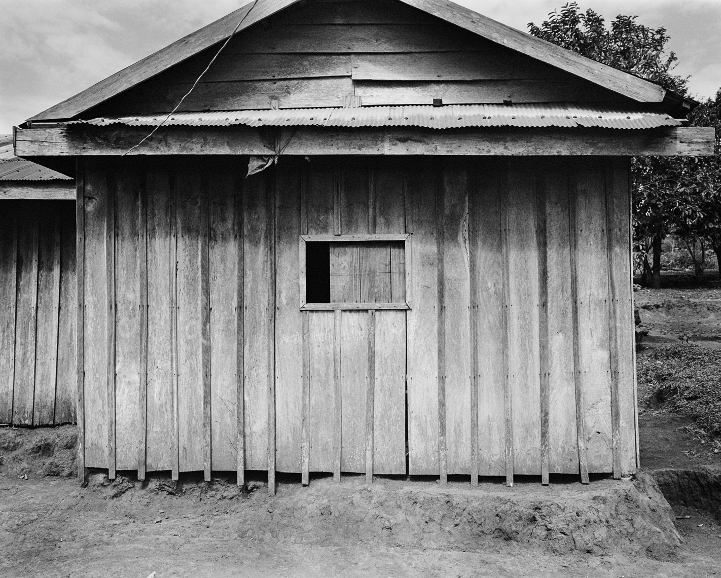 hut-w-wood-shuttered-window